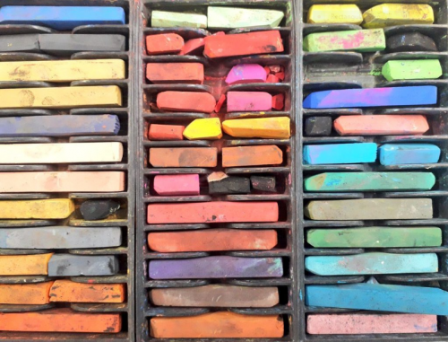 Coloured blocks of pastels in a compartmented box